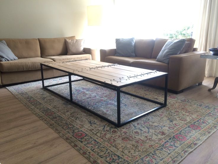 recouloured vintage rug by Sissy-boy homeland, sofa's by Cartel living, salon table vintage.