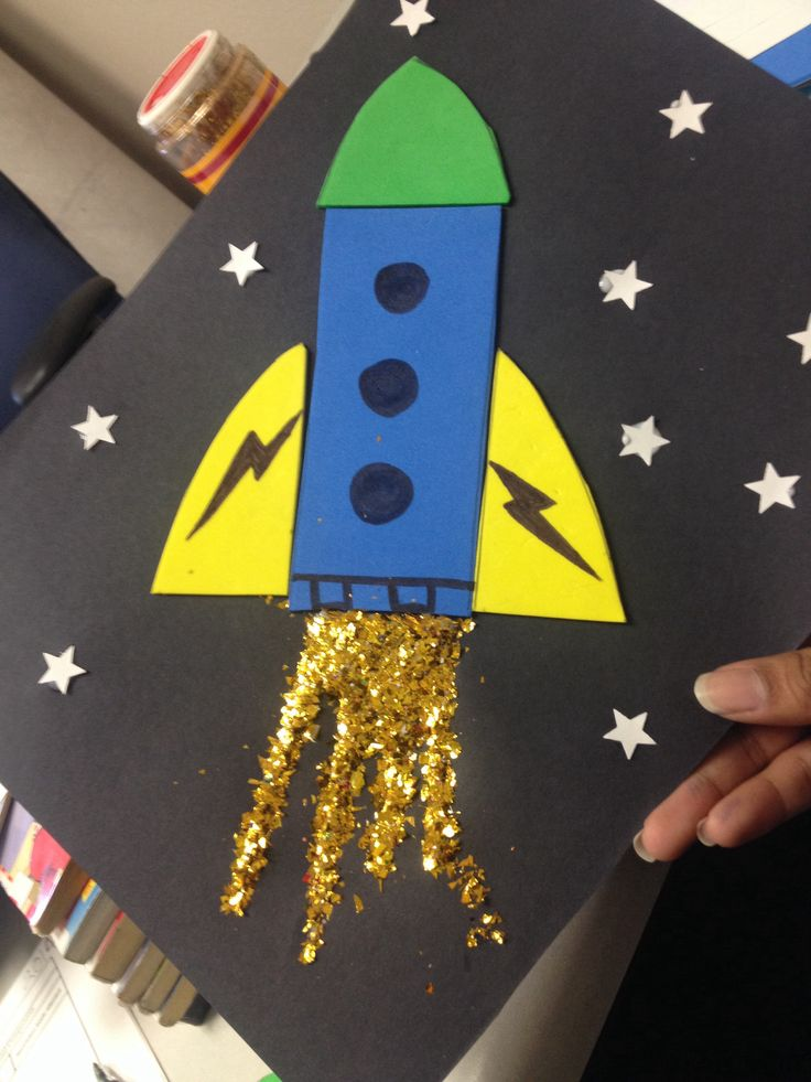 Rocket ship with glitter fire in space! A craft I made for our Storytime kids at the library . Great for primary age children, even preschool! Helps with shapes and motor skills. I used foam sheets for the rocket and star hole puncher for the space atmosphere .