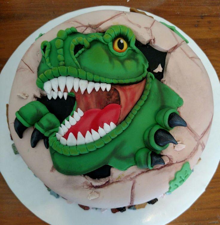 T-Rex Dinosaur T-Rex dinosaur fondant cake, edible candy rock border.