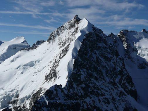 The full Bianco Ridge,with peak Piz Bernina. Seen from peak Piz Morteratsch. Bernina Mountains / Switzerland