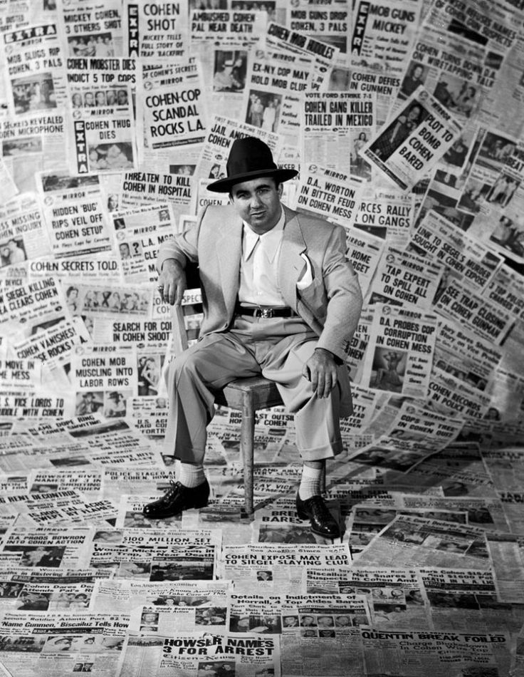 """""""Gangster Mickey Cohen sits amid the front pages of newspapers that helped make him the city's' most infamous citizen, Los Angeles, 1949.""""    Read more: http://life.time.com/crime/mickey-cohen-photos-of-a-legendary-los-angeles-mobster-1949/#ixzz2X1nqD0tk"""