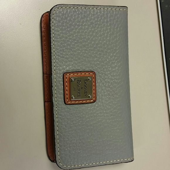 Dooney & bourke pebble leather phone and credit Leather dooney card case. Has 3 card slots and larger pocket on right. Pocket is too small for iPhone 5 or galaxy phones. Color is smoke. 5.5 x 3 x 1. Brand new, never used but I don't have the original packaging Dooney & Bourke Bags