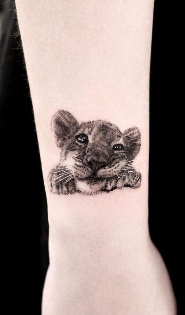 40 Creative Animal Tattoos Meanings Of Popular Tattoo Designs Of Animals In 2020 Small Lion Tattoo Small Lion Tattoo For Women Cubs Tattoo