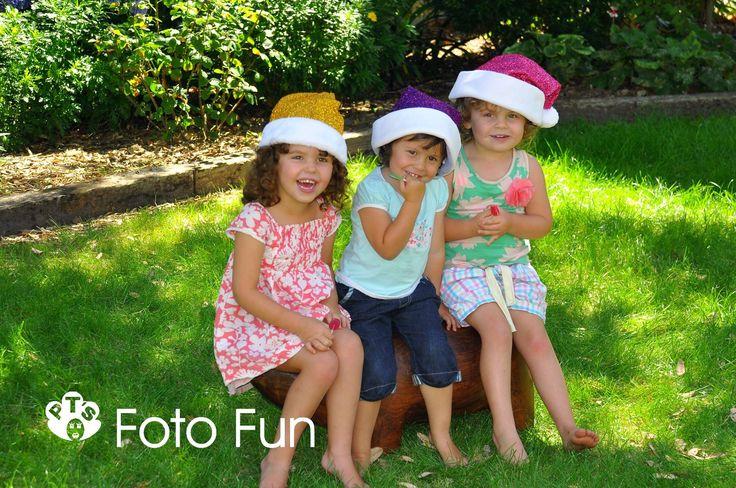 3 little christmassy girls in garden