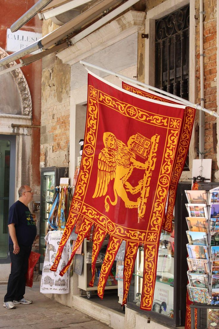 "The Flag of the Republic of Venice shows a winged lion with its paw on a book.  On the book is written ""Peace be upon you, O Mark, my Evangelist"" in Latin."