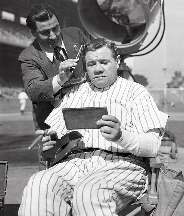 """Babe Ruth getting touched up before appearing as himself in the movie """"Pride of the Yankees"""". (1942)"""