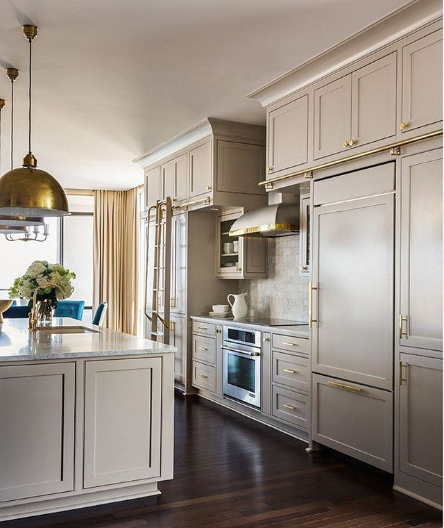 Paintcolor is Sherwin Williams Anew Gray #SW7030. Designed by Tobi Fairley. Love the gray and brass.