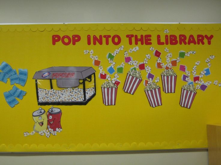 Totally could make this cooler by using those packing popcorns to make it look a little more 3.D. and adding real book covers to those little books or titles.
