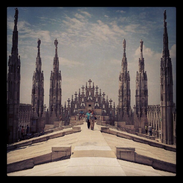 Walking on the rooftop of Milan's Duomo cathedral in Italy