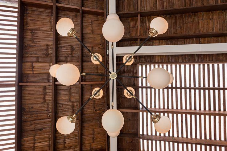 Vintage globe pendant light (chandelier) at Home Burgers. Bronze details. A burger restaurant at Bogota, Colombia.