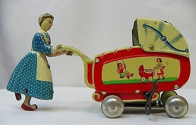 Antique U s Zone Germany Metal Woman Pushing Baby Carriage Windup Litho Tin Toy