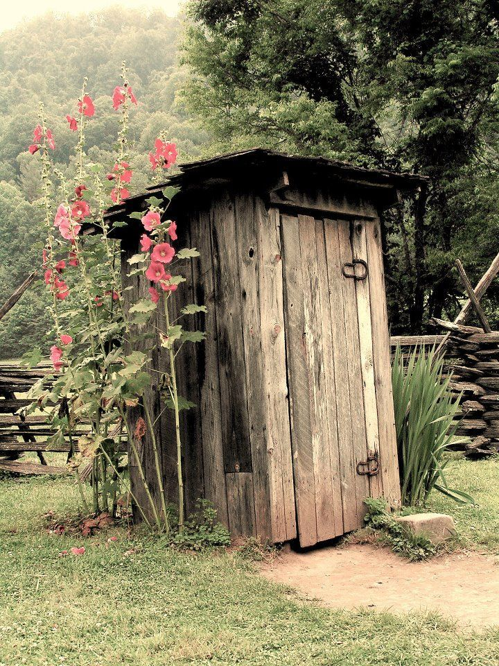 Garden tool shed made to look like an outhouse