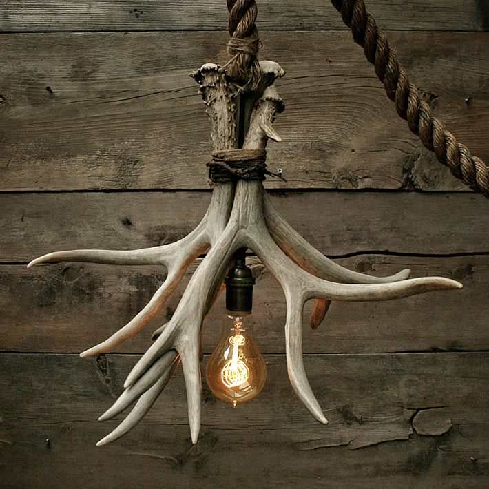 Moon Stone Fox, an upcycling shop on Etsy, created this unique lamp called 'Cabin Lit Chandelier'. Its made out of 3 Grade A shed antlers.