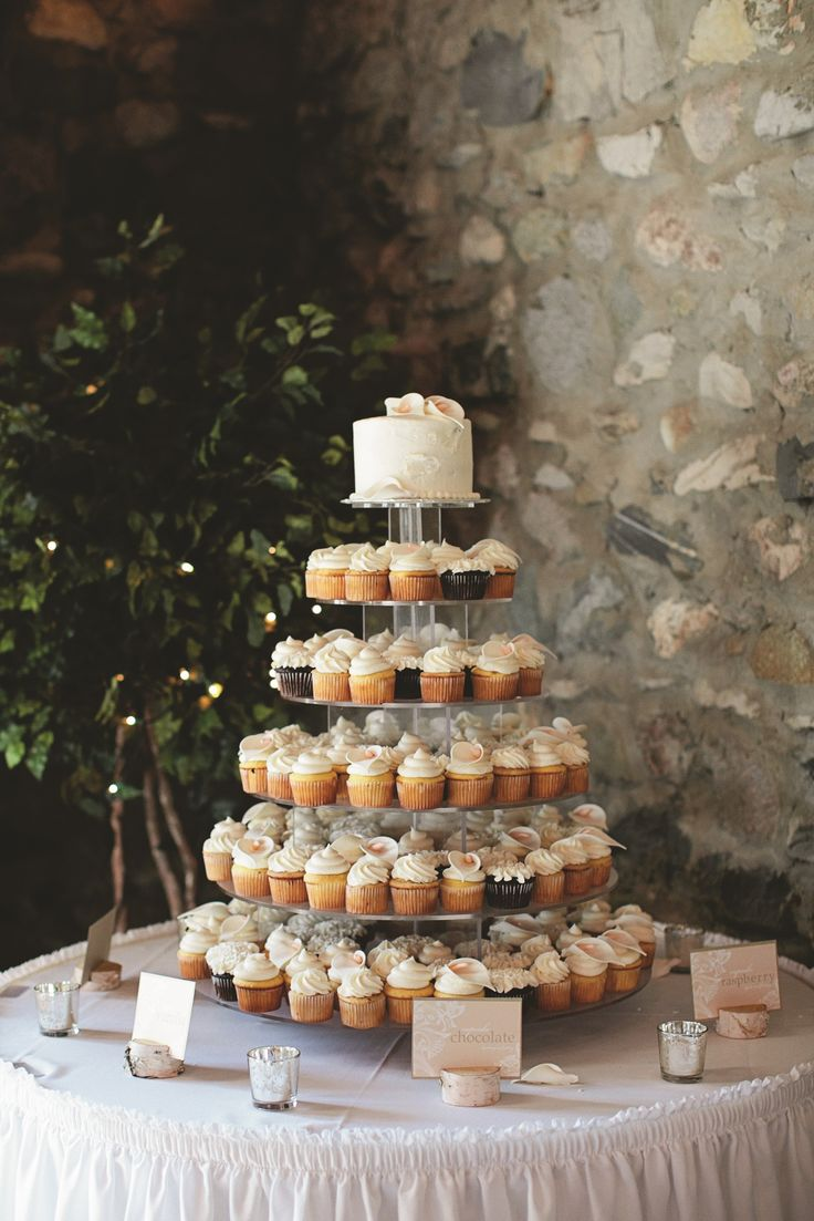 Should she go with cupcakes or a traditional wedding cake? | Photo: E.C. Campbell Photography