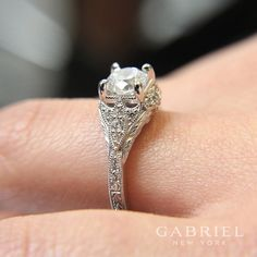 Gabriel NY - Preferred Fine Jewelry and Bridal Brand. Vintage and antique 14k White Gold Round Halo Engagement Ring. This fairy-tale engagement ring features an exceptional diamond halo. Marquis-shaped diamond clusters adorn the shoulders of the white gold band, bracketed by rich engraved details and finished with milgrain borders. Find your nearest retailer-> https://www.gabrielny.com/storelocator