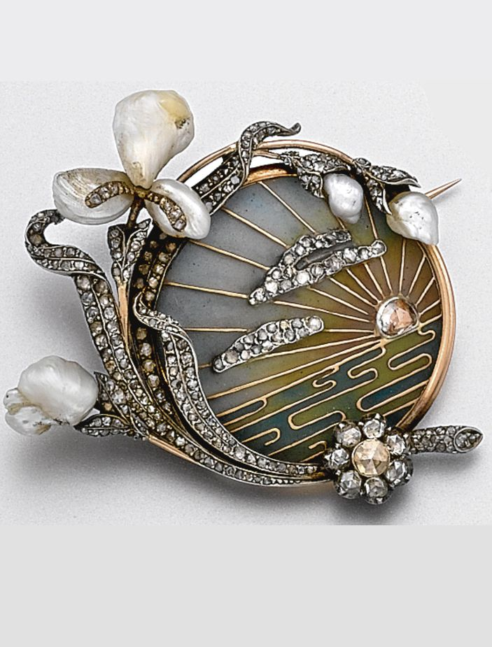 An Art Nouveau plique-à-jour enamel, diamond and pearl brooch, circa 1900. Depicting a rose-cut diamond sun setting over water with rose diamond clouds overhead, in a ground of blue, rose, and green plique-à-jour enamel, the border decorated with a spray of irises and buds of baroque pearls and rose-cut diamonds, mounted in rose gold and silver, a glazed compartment on the back.: