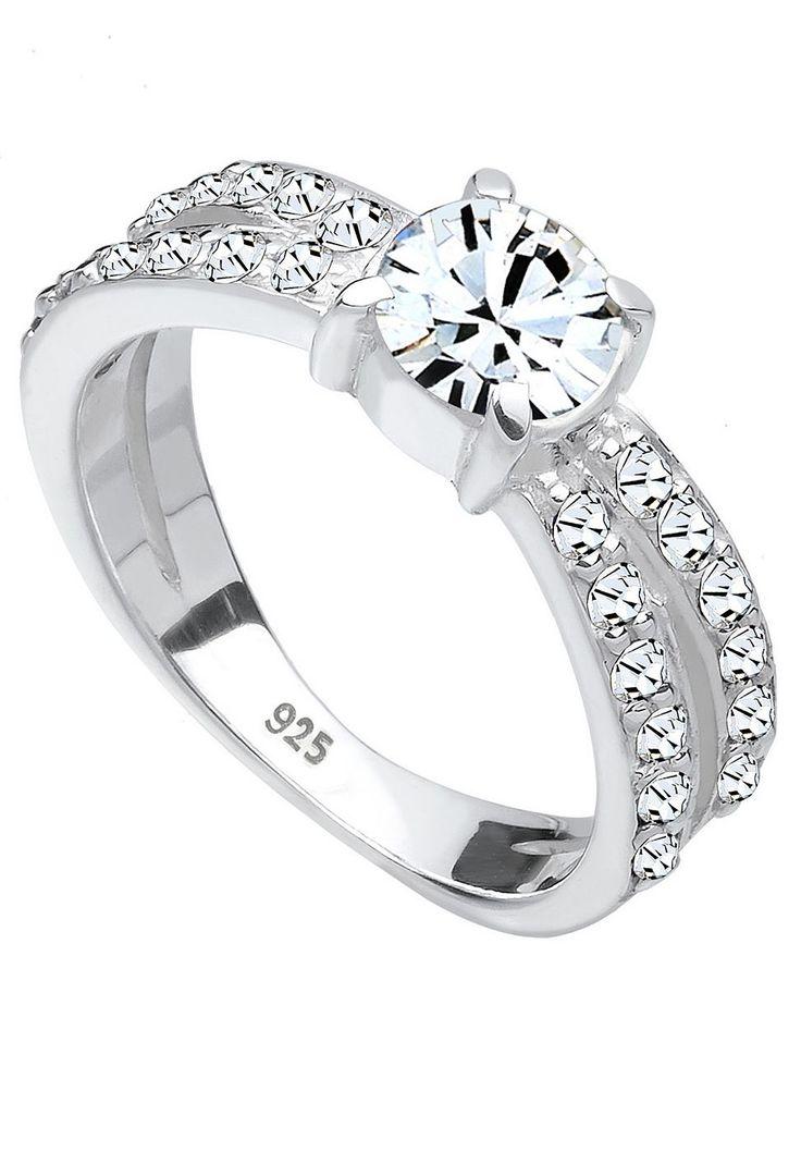 """Wunderschöner geschwungener Ring aus feinem 925er Sterlingsilber, zweireihig besetzt mit 24 Kristallen (1.5mm) von Swarovski in CRYSTAL, einem funkelnden Weiß, und einem Kristall (6mm) in Krappenfassung ebenfalls von Swarovski in CRYSTAL.  Weitere Hilfe zur Ringgröße:  Angegebene Größe in mm entspricht """"Ring Innen-Umfang"""", Umrechnung in """"Ring Durchmesser Ø"""" wie folgt:  52mm Umfang = 16,5mm Ø 54..."""