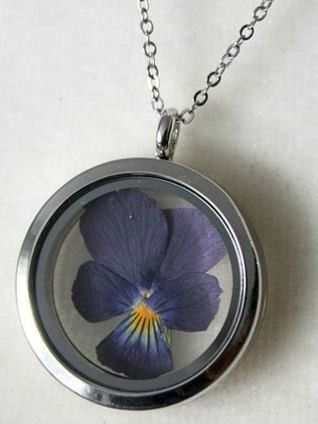 Pansy Pendant | This jewellery features hand picked and pressed plants grown in a greenhouse by the designer herself! Some pieces also feature foraged natural items such as ferns, lichen and moss, leaves, and seashells gathered from Eastern Quebec and the Bas St-Laurent region. #torontofashion #CanadianDesigners #canadianfashion #canadianfashionblogger #madeincanada #canadiandesigner #canadianbrands #jewellery  #torontojewelry #canadian #necklace #pendant #locket #madeinquebec