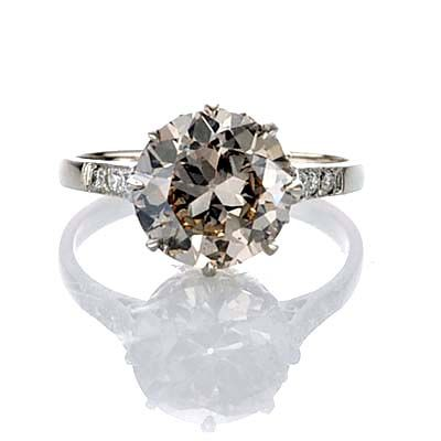 I love unique rings... like the color of this diamond!
