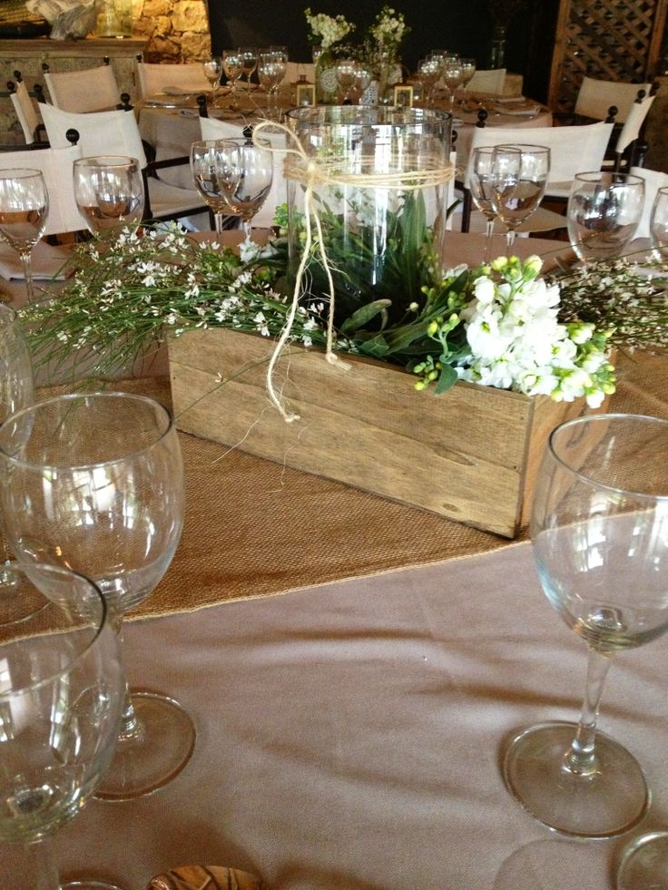 Country wedding centerpiece but use ball mason jars and