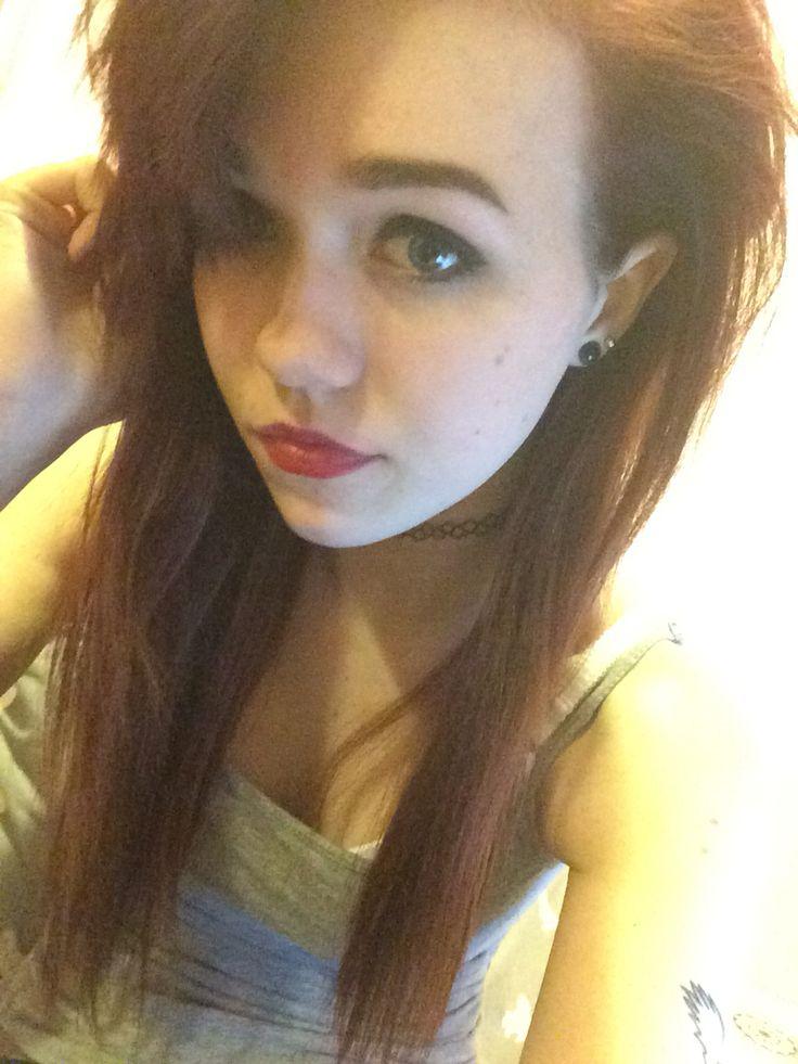 Makeup, gauged ears, choker, tattoo
