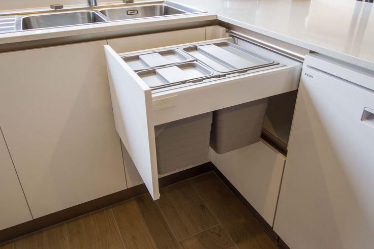 Brilliant bin storage, clean and tidy! Small, modern kitchen. www.thekitchendesigncentre.com.au @thekitchen_designcentre