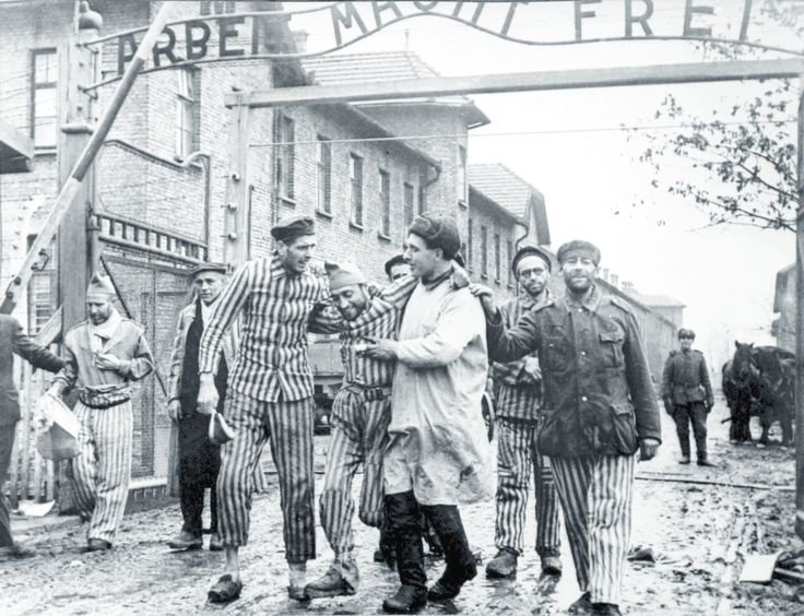 A Red Army man with prisoners at the Nazi Vernichtungslager (Extermination  Camp) at Oświęcim in Upper Silesia. It's better known by its German name… Auschwitz.