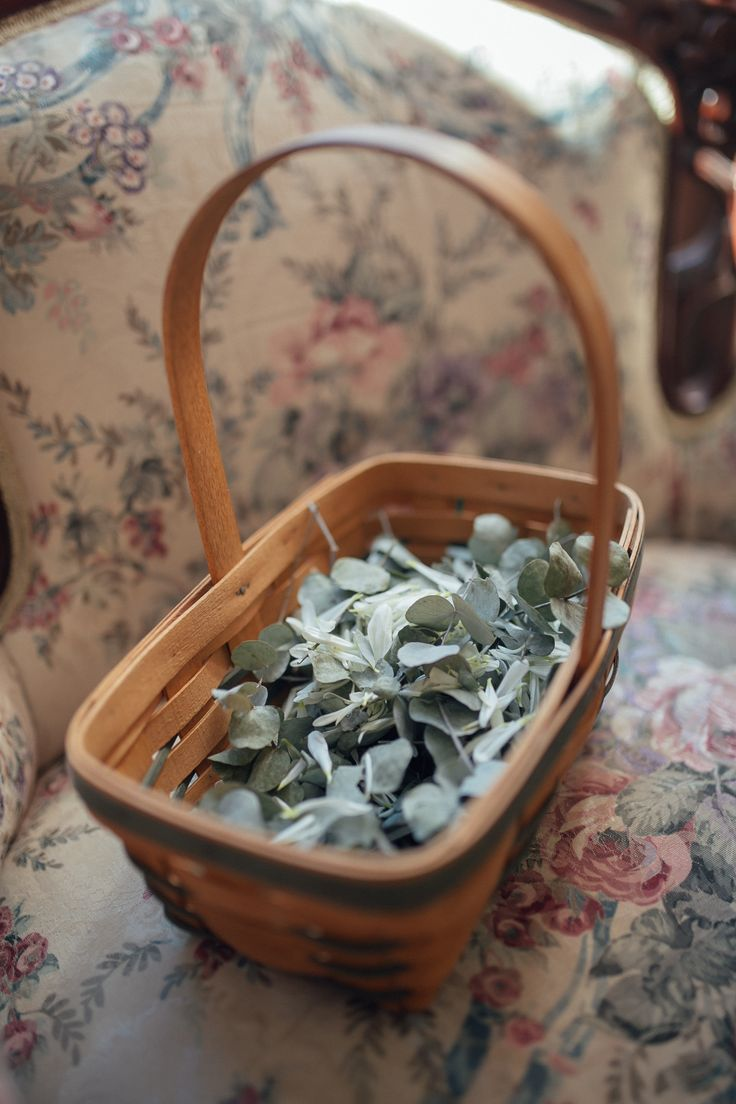 Longaberger flower girl basket. Dried eucalyptus and flowers instead of rose petals for the wedding processional!
