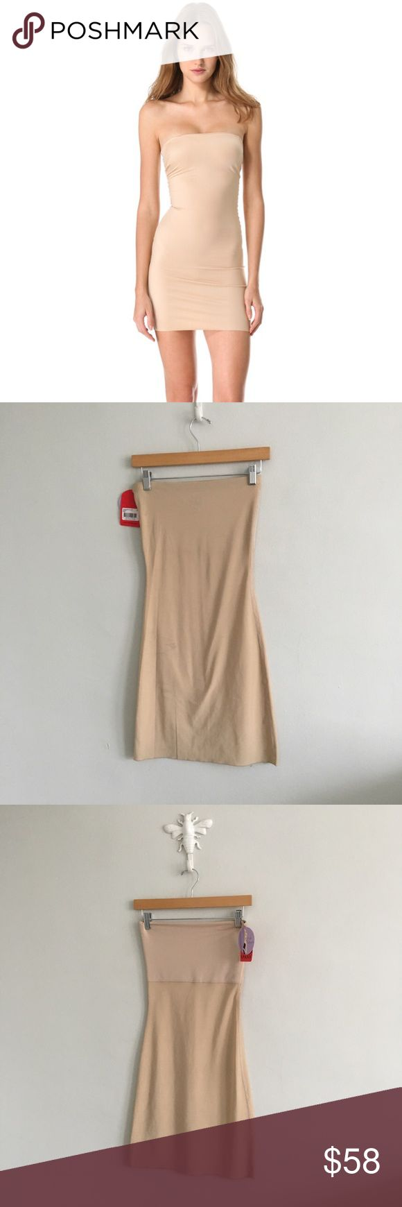 """Spanx Strapless Shapewear Full Slip in Nude There is one faint mark - which should come out when washed - and a tiny pull. New with tags. Chest: 90% polyester, 10% spandex. Body: 87% polyester, 13% spandex. Length: 29"""". Spanx Strapless Full Slip Nude Size M Lingerie Shapewear NWT Strapless SPANX Intimates & Sleepwear Shapewear"""