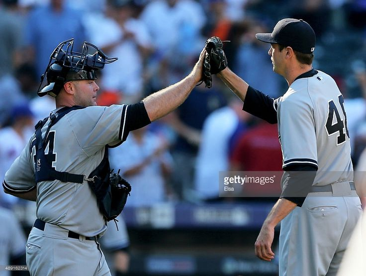 Brian McCann #34 and Andrew Miller #48 of the New York Yankees celebrate the win over the New York Mets during interleague play on September 19, 2015 at Citi Field in the Flushing neighborhood of the Queens borough of New York City.The New York Yankees defeated the New York Mets 5-0.