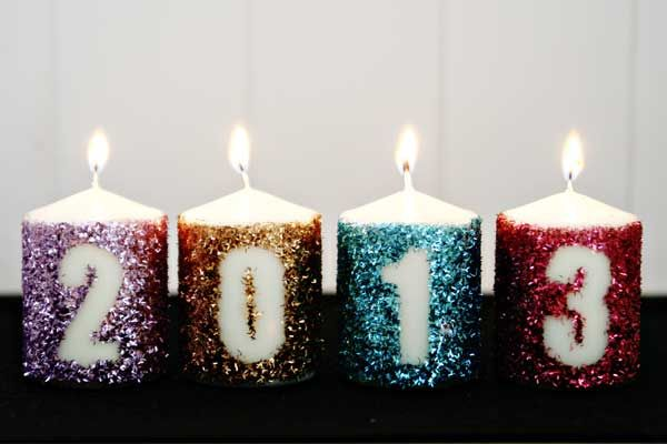 Glitter New Year's Eve Candles at ThinkCrafts.com Welcome the New Year with some sparkle! All of your friends will know that you plan on making 2013 much more fabulous than 2012 after seeing these glittery glowing candles. They're surprisingly easy to whip up and they make the perfect statement for your New Year's Eve festivities!