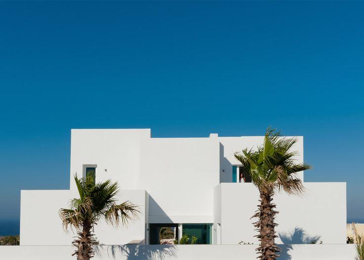 Irregularly stacked white blocks make up Santorini house by Kapsimalis Architects