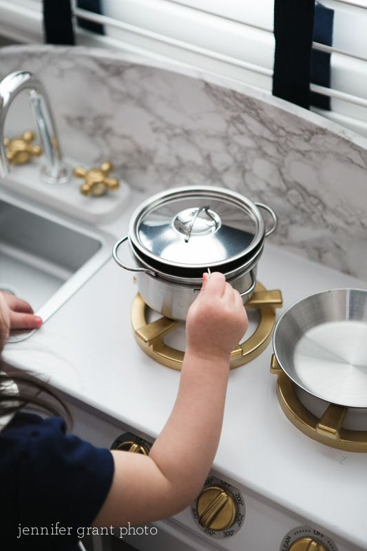 """Playroom DIY - spray paint the fixtures on your kitchen set for an adorable upgrade. Love these """"brass"""" fixtures on this kitchen play set!"""