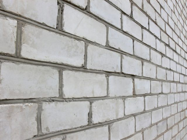 How To Install Shelves On A Brick Or Concrete Wall Hunker Concrete Block Walls Concrete Wall Concrete Blocks