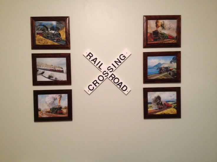 """Great for a wall in a train themed bedroom.  I found various train pictures online for free download, got them printed in 8x10's at Walgreens, and bought cheap frames at Walmart.  I painted some wood white and used poster board letters to write """"RAILROAD CROSSING"""".  My son loves it!"""
