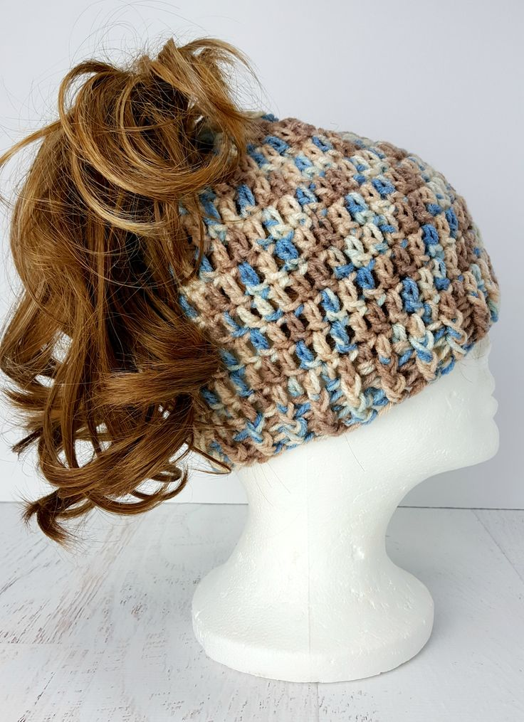 """Learn to crochet this easy """"Messy Bun"""" hat. Super fun, easy and quick to make. They make great gifts. Fun, fun, fun. Blog post also includes link to free YouTube video tutorial."""