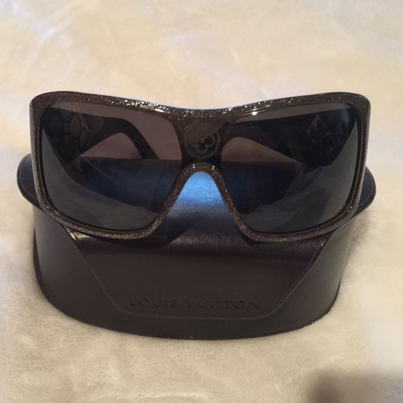 Authentic Louis Vuitton sunglasses Large lenses in pewter colored frames with classic LV logo detailing. Louis Vuitton Accessories Sunglasses