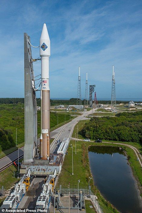 In this photo provided by the United Launch Alliance, an Atlas V rocket carrying the Orbital ATK Cygnus spacecraft, is rolled from the Vertical Integration Facility to a launch pad at the Cape Canaveral Air Force Station in Cape Canaveral, Fla., on Wednesday, Dec. 2, 2015.