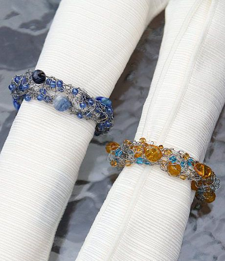 Free Knitting Pattern for Venezia Beaded Napkin Rings - Knit with wire and beads, these napkin rings make stunning gifts as well as table decorations. Some knitters have adapted the pattern as a bracelet. Designed by Rosemary (Romi) Hill. Pictured project byclsmiller