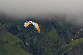"""#Adventure in the Himalayas - ParaSailing and #ParaGliding - #Parasailing, also known as parascending, or """"parakiting"""" is a recreational kiting activity where a person is towed behind a vehicle [usually a boat] while attached to a specially designed canopy wing that reminds one of a parachute, known as a parasail wing. #wanderlust #fun"""