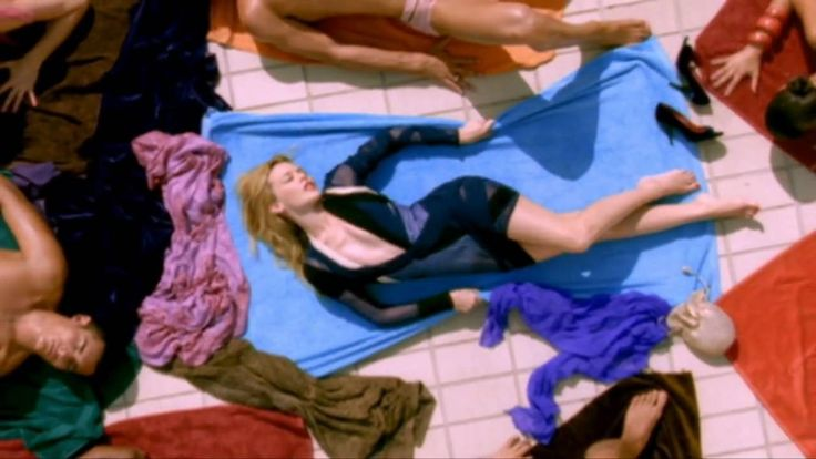 Kylie Minogue - Slow  That scene is at the Olympic HIgh Diving pool in Barcelona, Spain.