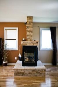 fireplace as a room divider | Peninsula fireplaces can become beautiful, useful room dividers.