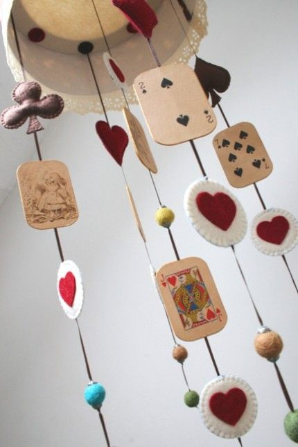 Awesome mobile! Love the Alice in Wonderland theme for a girl's nursery!