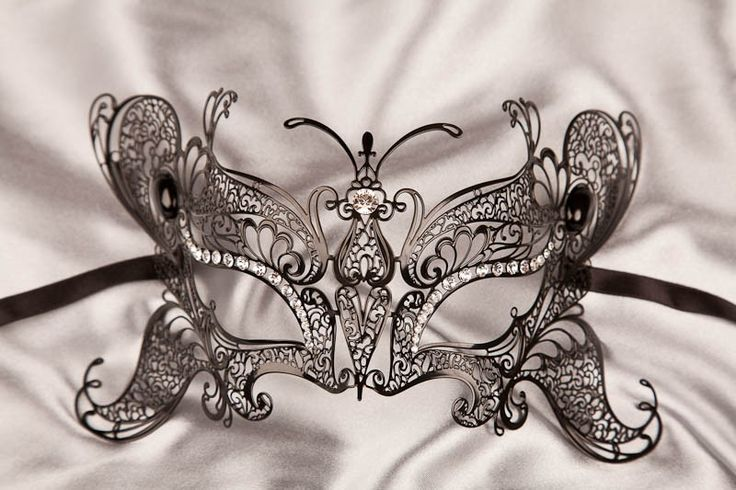 If you're hoping to cause a stir with your masquerade costume at a masked ball or masquerade party, then the Luxury Butterfly Filigree Metal Lace mask could be the pièce de résistance to your ensemble. It's a stunning display of unusual Filigree metalwork that has been cut into the shape of a beautiful butterfly with a central body and expansive wings that cover the wearer's eyes, cheeks and forehead. To achieve the stunning Filigree lace effect, lightweight me...