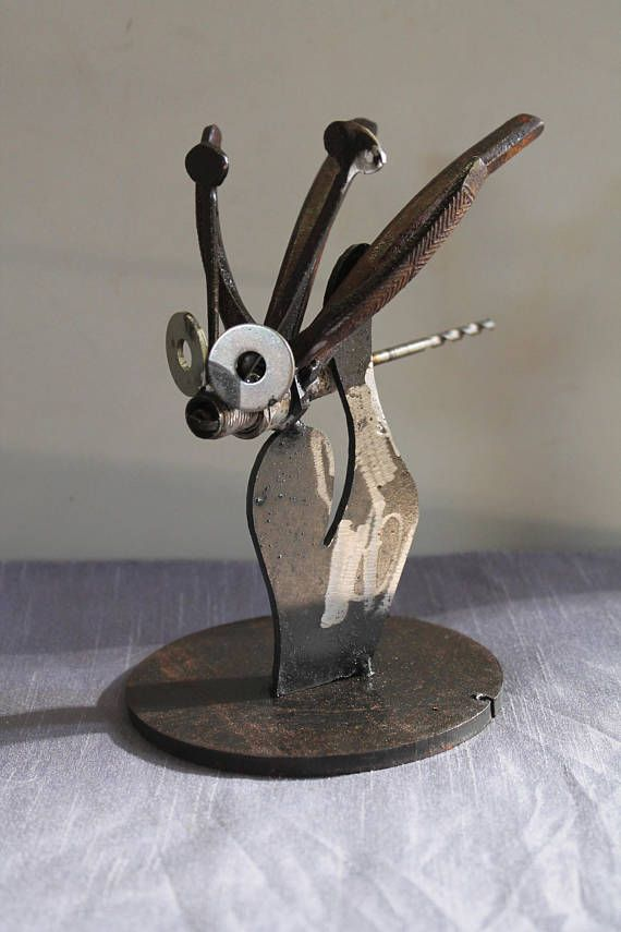 Check out this item in my Etsy shop https://www.etsy.com/au/listing/559508474/scrap-metal-art-bug-on-a-plant-cacti