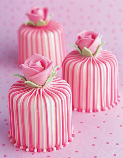 striped cake with dainty pink roses