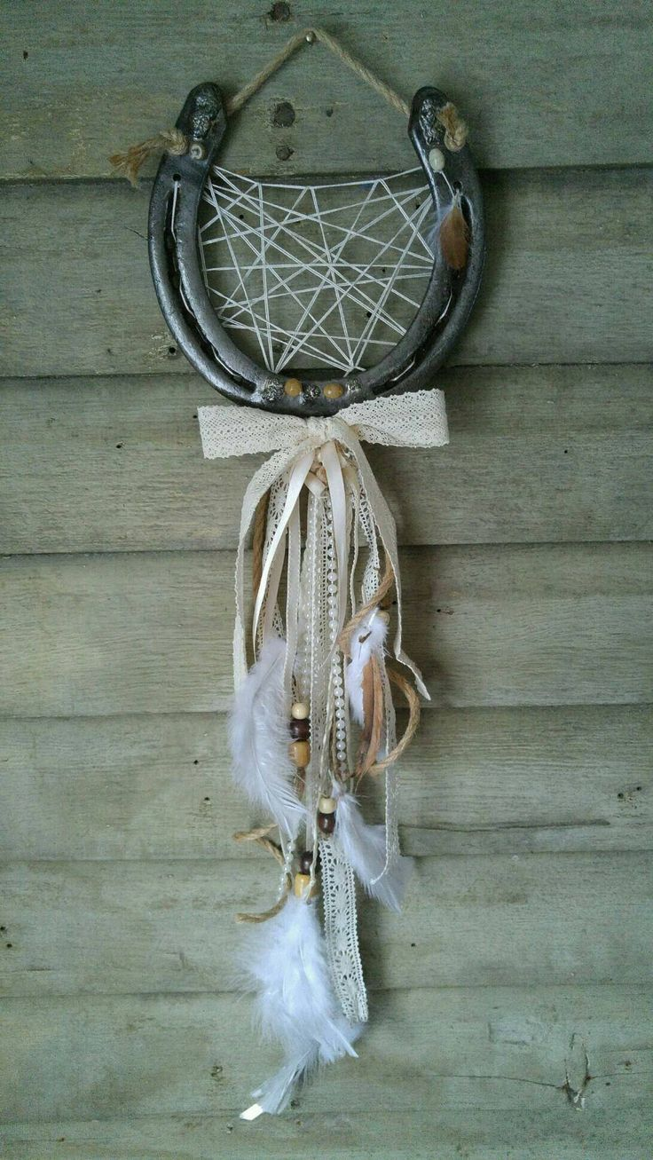 "A rustic horseshoe wedding luck catcher, a beautiful home decor piece that gives you luck for a life time! Wedding day decor, country home decor, etsy shop, rustic decor, wedding gifts, valentines day gift, feather decor, horseshoe wedding decor Large real draft horseshoe and 30"" long hanging!"