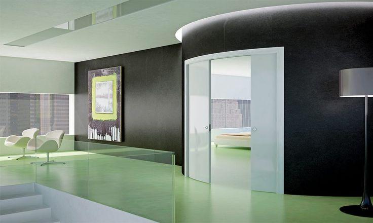Arkimede Doppio - Il controtelaio curvo a due ante, la soluzione di design più impattante per stili di arredamento moderni e uffici di alta rappresentanza.