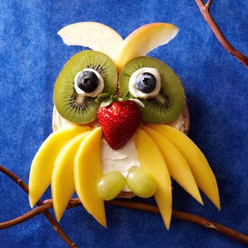 Owl made of bagels, cream cheese adn fruit..I love making faces on foods with my grandboys! They love it too!