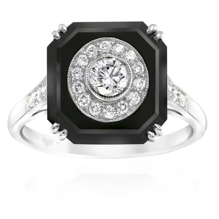 Noir onyx and diamond dress ring. Inspired by the striking style of the Art Deco period. Embellished with mille graining around the diamonds. Crafted in 18ct white gold. Width at top of ring: 10.5mm. This ring will be customised to perfectly fit your finger, which may take up to 6 weeks.